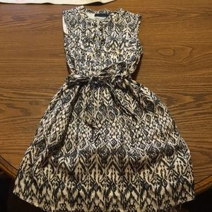 Fully lined sleeveless dress. Navy and cream color